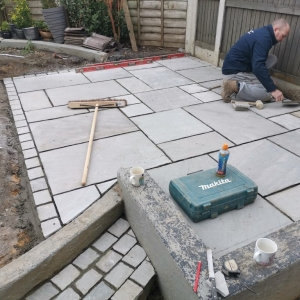 Dave laying patio
